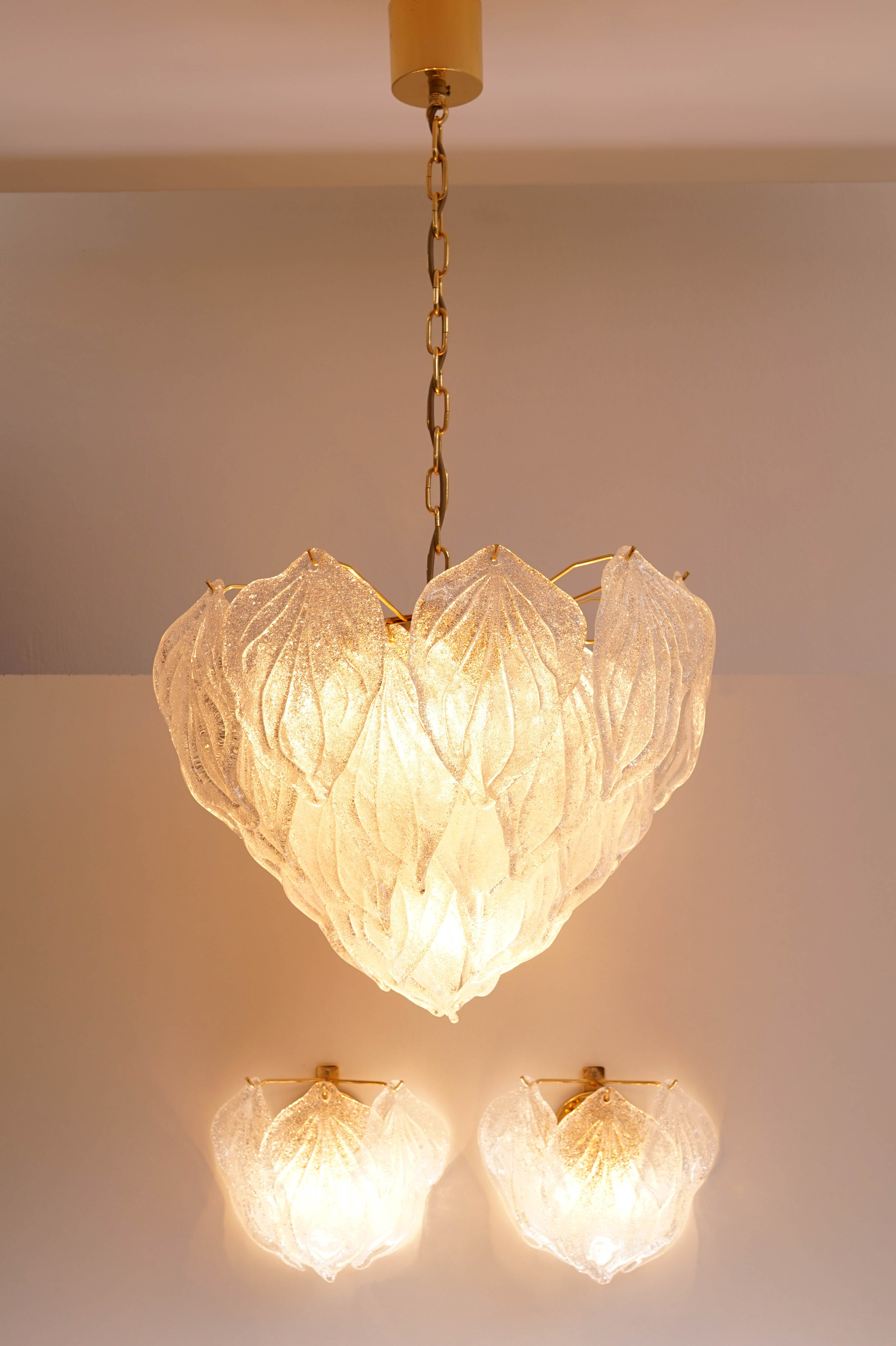 Wall sconces and chandelier by Novaresi